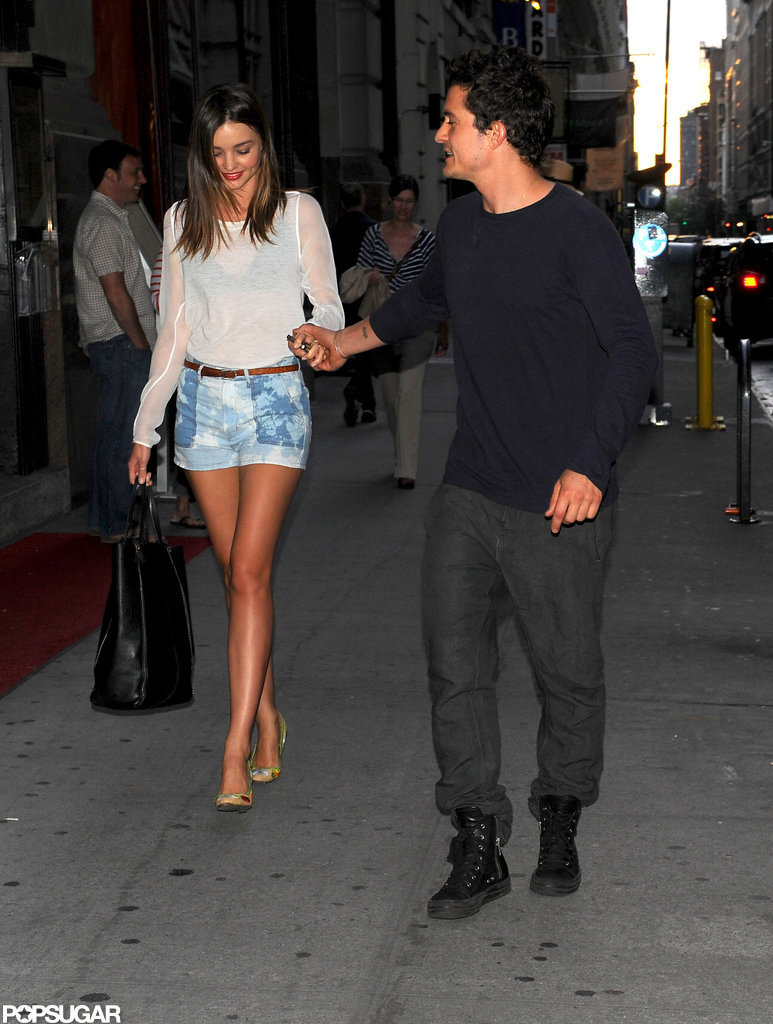 Orlando and Miranda Hold Hands on a City Walk