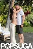 Pregnant Megan shared a kiss with her man during a June 2012 trip to Hawaii.