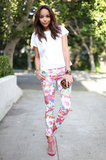 Ashley Madekwe knows how to style up a high-low outfit and one of her go-to favorites for the task? Zara, of course. Here, she sports a sexy pink sandal that provides a more formal touch to this floral jean look.