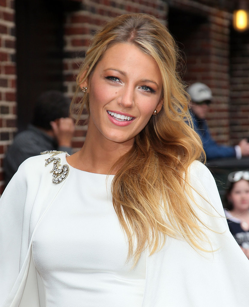 Blake added interest to her more conservative white dress with a brooch at the neckline.