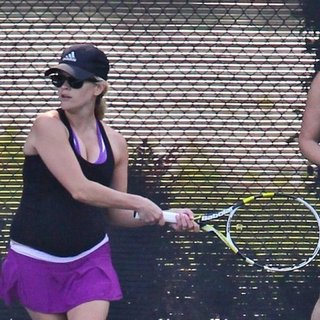 Reese Witherspoon Playing Tennis in Purple Skirt