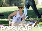 Gwen Stefani wore a hat and shades while sitting in an LA park.