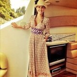 Bar Refaeli donned a printed maxi dress and straw hat during a day in the sun. Source: Instagram user iambarrefaeli
