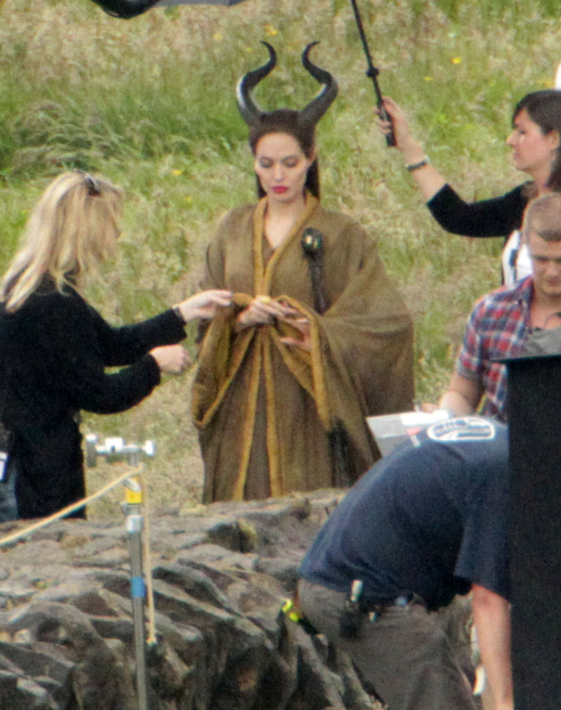 Angelina Jolie wore a dramatic costume to film Maleficent in the UK in June.