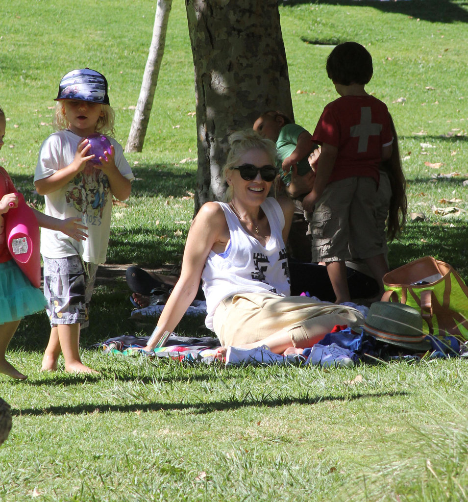 Gwen Stefani hung out in the shade while her boys played at the park.
