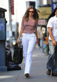Miranda Kerr wore white bell-bottom pants in NYC.