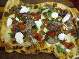 Grilled Pizza With Hot Sausage, Grilled Peppers, and Onions