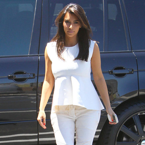 Kim Kardashian Wearing a White Peplum Top