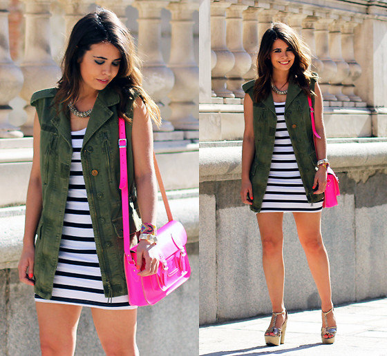 Pop a long sleeveless vest over your favorite striped dress for a military-inspired, slighty nautical Summer look. Photo courtesy of Lookbook.nu
