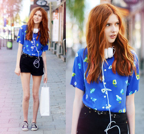 Add a dressed-up kick to your Converse sneakers with a pretty printed blouse and shorts. Photo courtesy of Lookbook.nu
