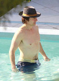 Tom Cruise celebrated his 49th birthday, swimming in Miami in July 2011.