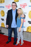 Tom Arnold and Kristen Bell posed together on the red carpet at the screening of Hit and Run.