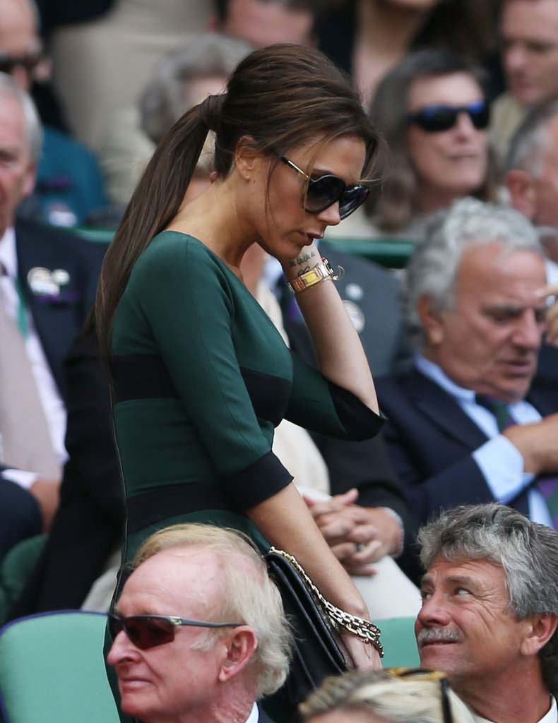 Victoria Beckham wore her hair pulled back with sunglasses.