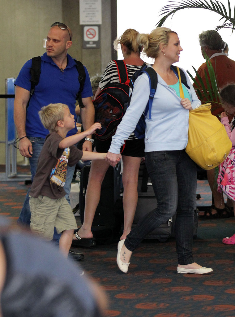 Britney Spears held her son Jayden's hand through the airport in Maui.