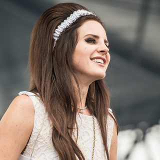 Lana Del Rey in a White Dress at a Music Festival in France
