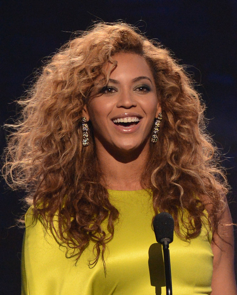 Beyonce left her hair full and voluminous, framing her face and revealing her glittering drop earrings.
