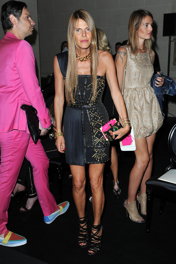 Anna Dello Russo maintained her attention-getting reputation in a one-shouldered Versace mini and a pair of seriously strappy heels.