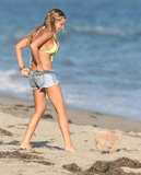 Ashley Tisdale wore a green bikini and played with her dog on the beach in Malibu.