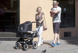 Chris Hemsworth went for a walk, holding baby India in Madrid.