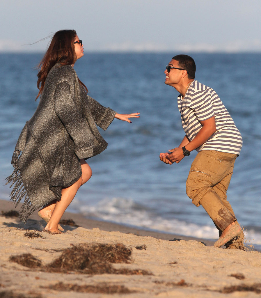Selena Gomez joked around with a male friend on the beach for Ashley Tisdale's birthday celebration.