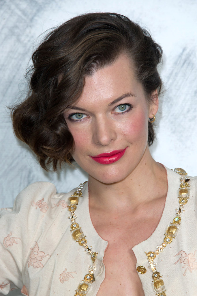 Milla Jovovich sported bright lips at the Chanel photocall in Paris.
