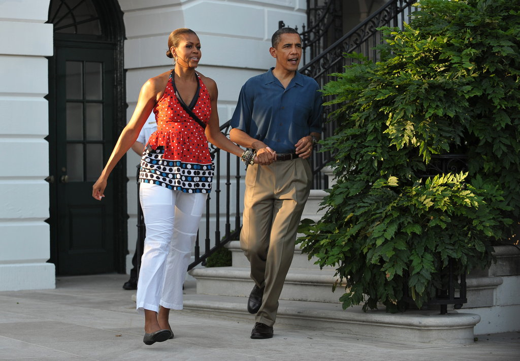 On July 4, 2010, Michelle and Barack hustled hand in hand to greet families at that year's barbecue.