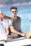 Zac Efron rode on a motorboat.