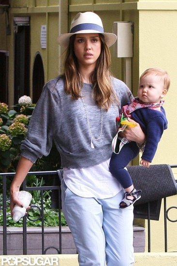 Jessica Alba carried a bottle in one hand and Haven Warren in the other.