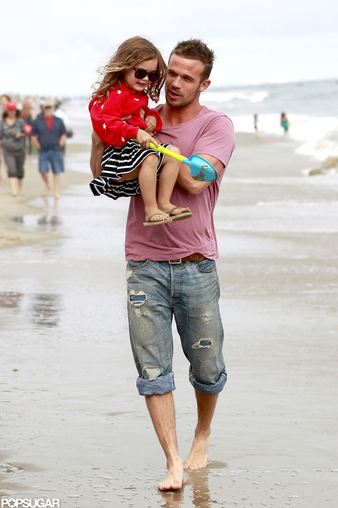 Cam Gigandet played with his daughter, Everleigh, during a Malibu beach party.