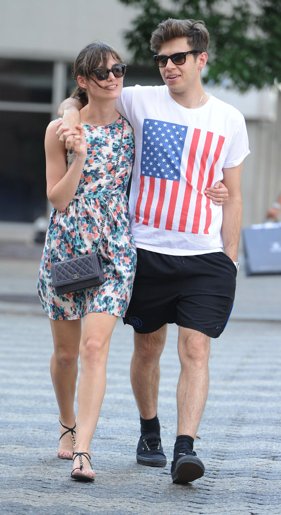 James Righton wore an American flag T-shirt and had his arm around Keira Knightley during a SoHo stroll in July 2012.