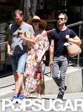 Anne Hathaway walked in NYC in a long floral dress on the Fourth of July.