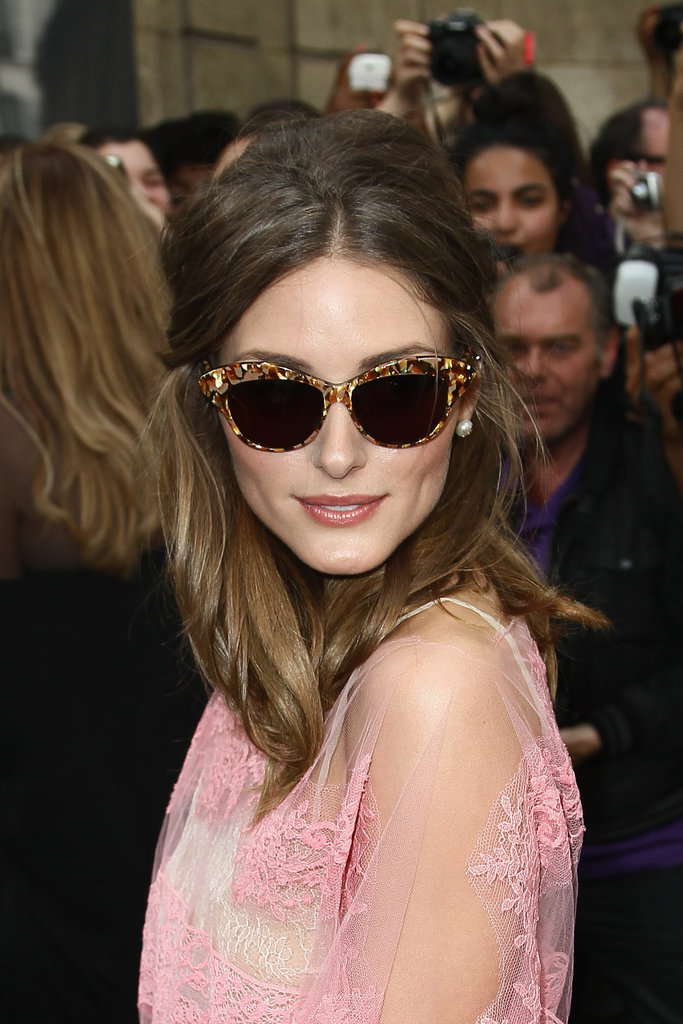 Olivia channeled Parisian glamour in her oversize shades and pearls.