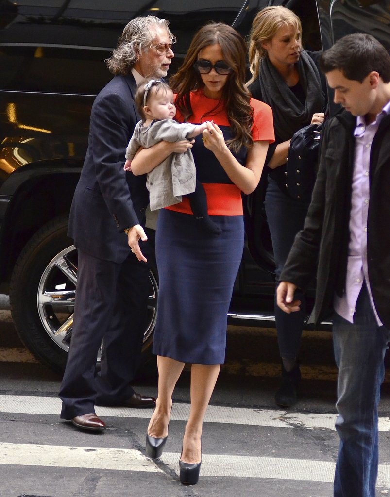 Victoria Beckham layered a sweater over an impeccably dressed Harper Beckham during a November 2011 stopover in NYC.
