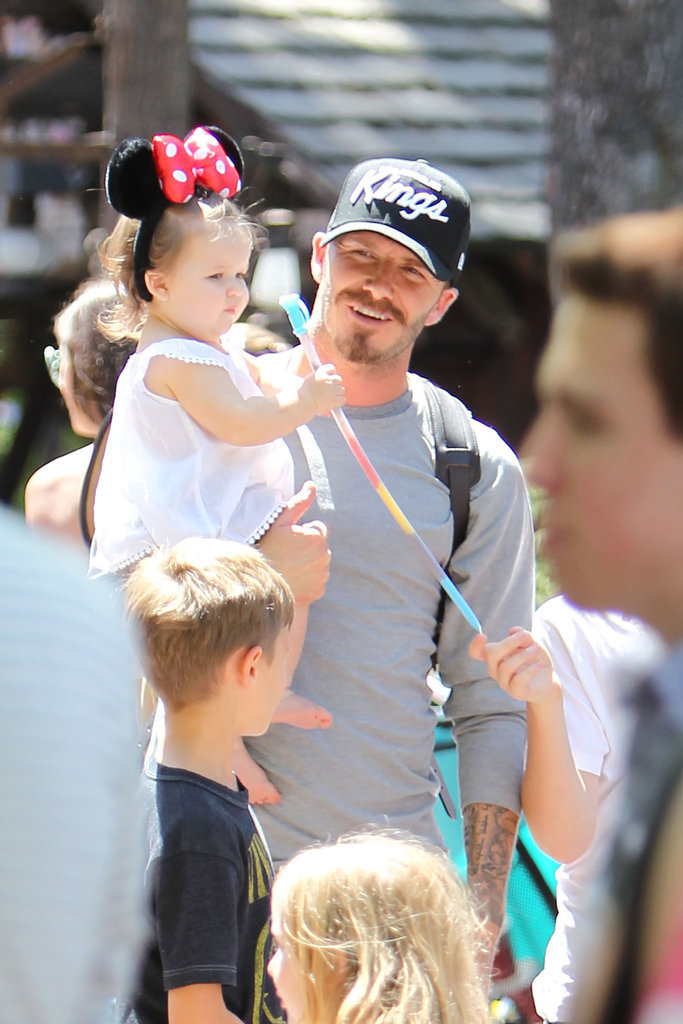 Harper Beckham got her own pair of Minnie Mouse ears during a family trip to Disneyland in early June 2012.