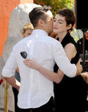 Anne Hathaway was greeted by Joseph Gordon-Levitt at Christopher Nolan's hand and footprint ceremony in LA.