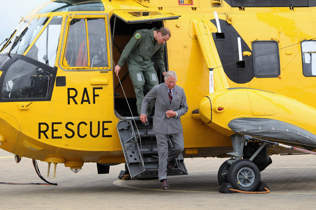 Prince William and Prince Charles exited the helicopter after checking out the inside.