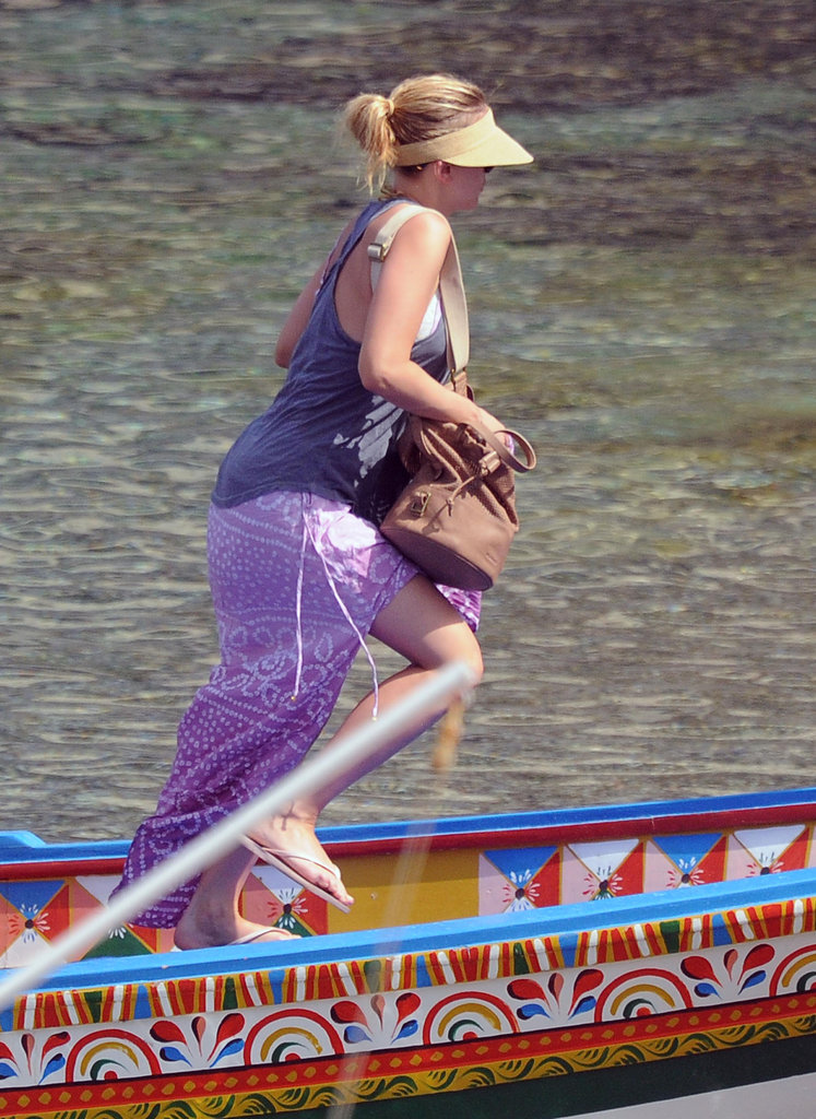 Scarlett Johansson hopped off a boat in a long purple skirt.