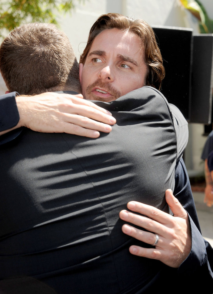 Christian Bale was embraced at Christopher Nolan's hand and footprint ceremony in LA.