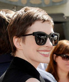 Anne Hathaway looked stylish in her shades at Christopher Nolan's hand and footprint ceremony in LA.