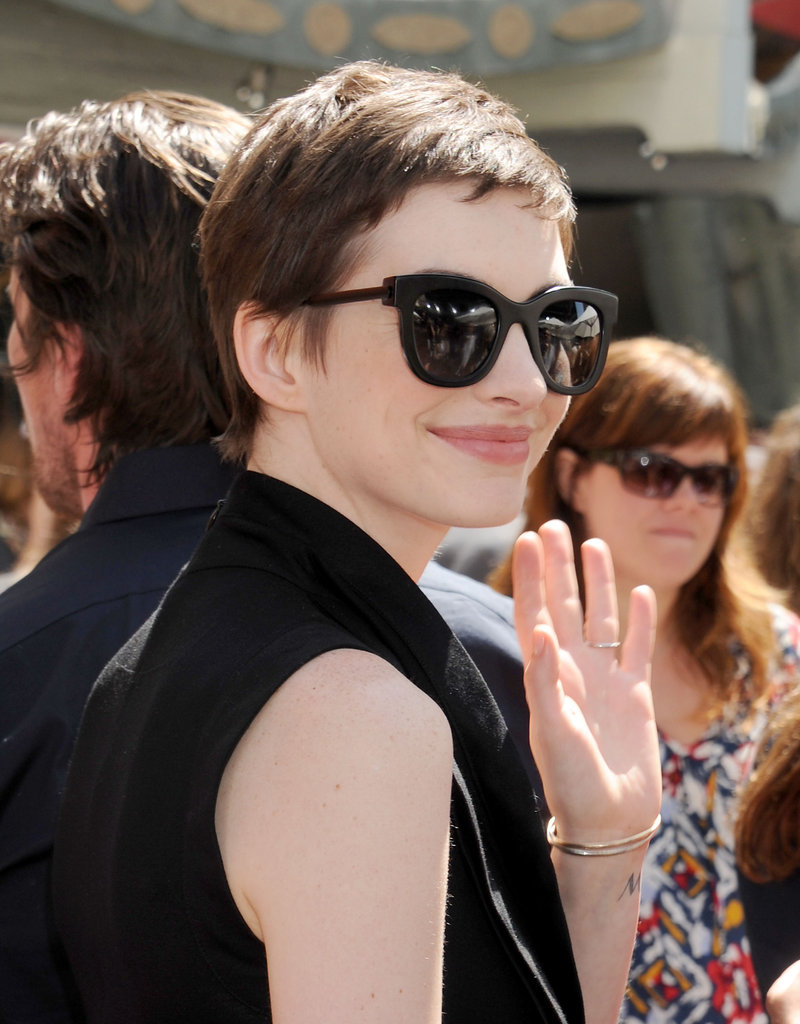 Anne Hathaway gave a wave at Christopher Nolan's hand and footprint ceremony in LA.
