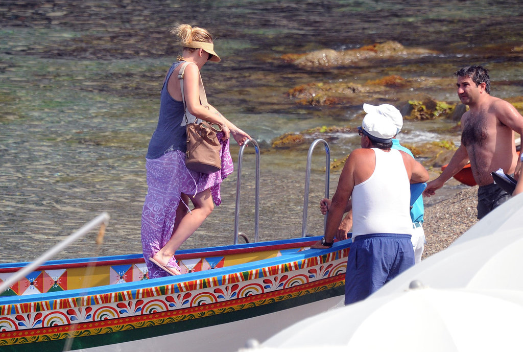 Scarlett Johansson looked perfect for a day of boating in a long purple skirt and tank top.