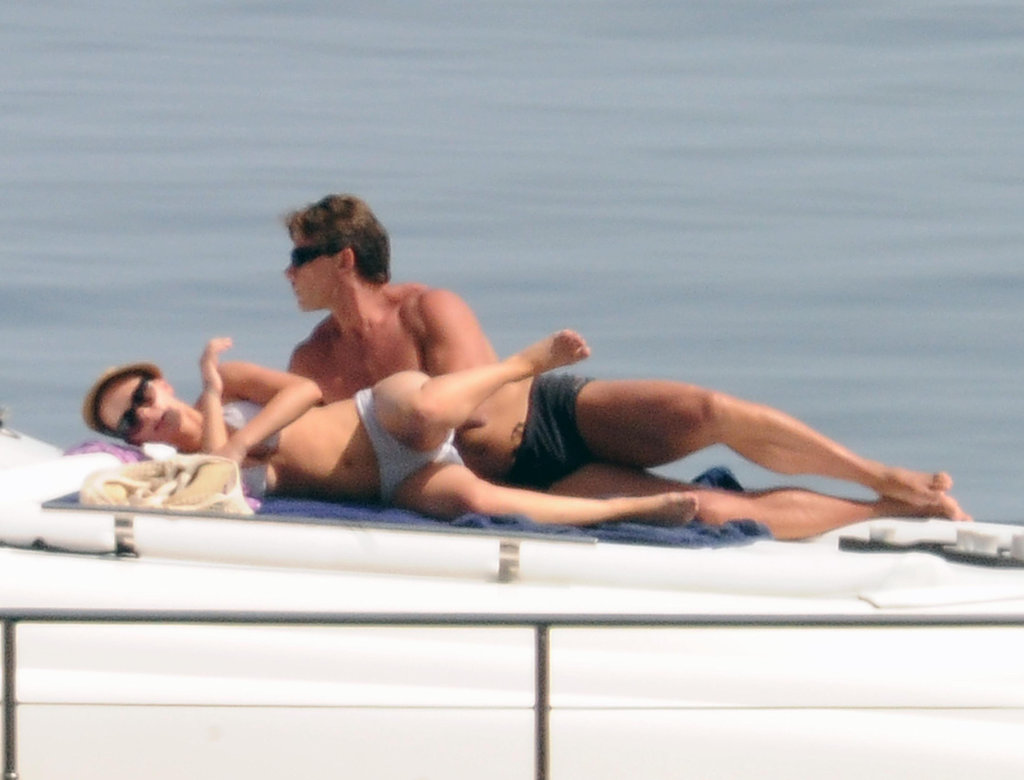 Scarlett Johansson laid out on a yacht with a friend.