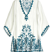 The bell sleeves and hand-embroidered turquoise blue detailing are reminiscent of exotic locales like Bali and Marrakech.