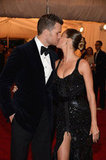 Tom Brady and Gisele Bündchen went in for a kiss on the red carpet at the Met Gala in May.