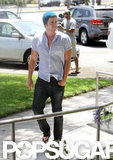 Liam Hemsworth Returns to Work on the West Coast With a Smile