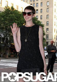 Anne Hathaway cheerfully waved while arriving at the Shut Up & Play the Hits screening in NYC.