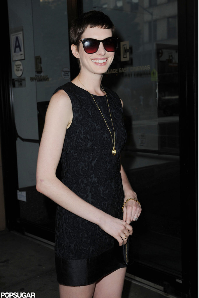 Anne Hathaway looked happy as she arrived at the Shut Up & Play the Hits screening in NYC.