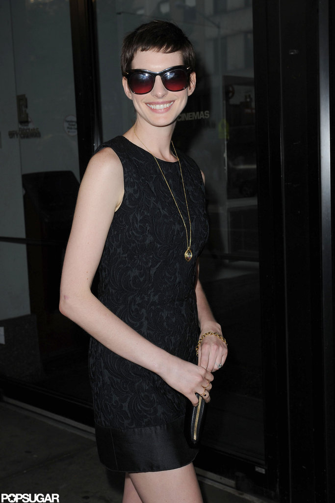 Anne Hathaway showed her pearly whites on the way into the Shut Up & Play the Hits screening in NYC.