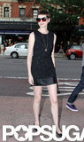 Anne Hathaway showed some leg in a short Dolce and Gabbana number for the Shut Up & Play the Hits screening in NYC.