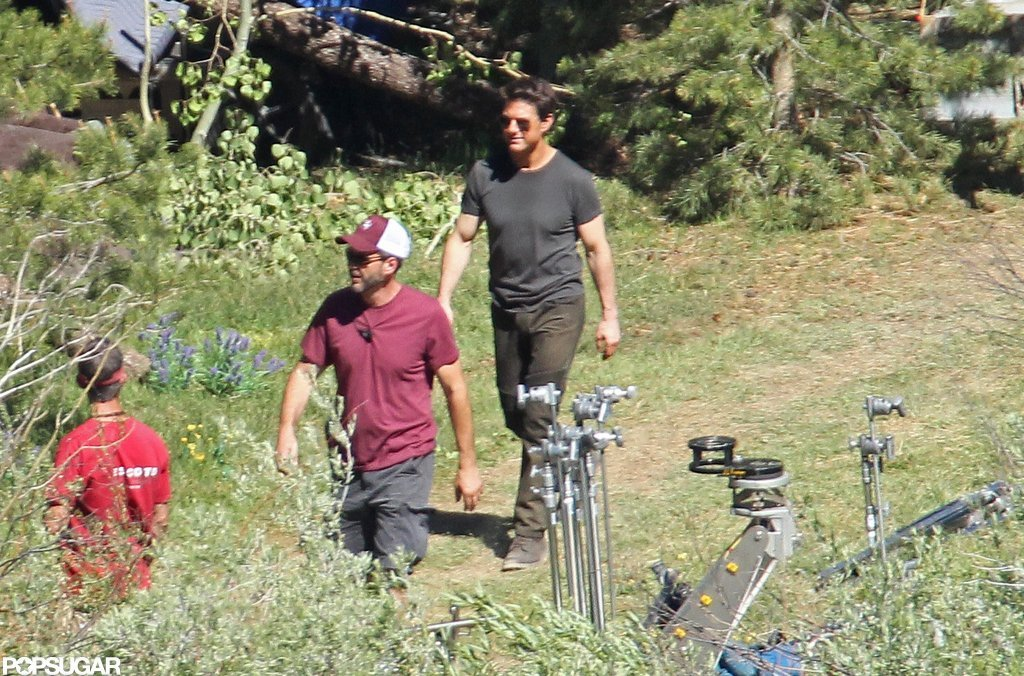 Tom Cruise was smiling as he walked on the Oblivion set in CA.